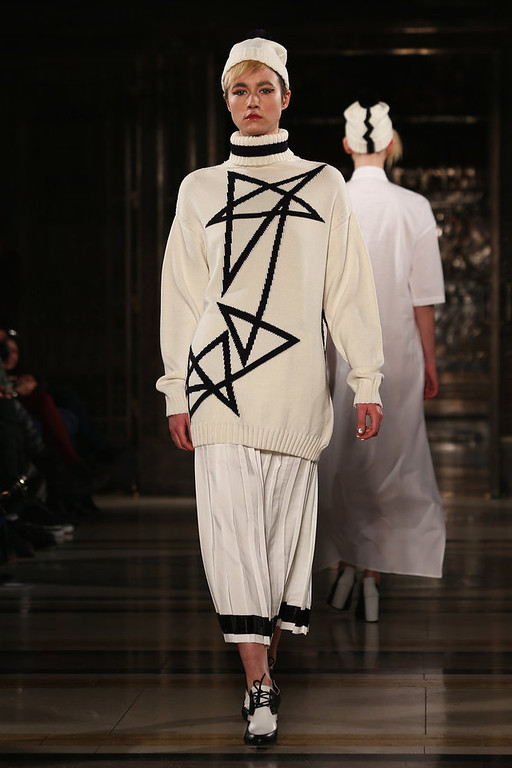 Description of . A model walks the runway at the Ming Pin Tien show during London Fashion Week Fall/Winter 2013/14 at Freemasons Hall on February 19, 2013 in London, England.  (Photo by Tim Whitby/Getty Images)