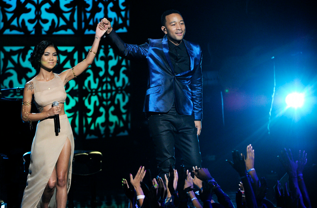 Description of . Jhene Aiko, left, and John Legend perform at the BET Awards at the Nokia Theatre on Sunday, June 29, 2014, in Los Angeles. (Photo by Chris Pizzello/Invision/AP)