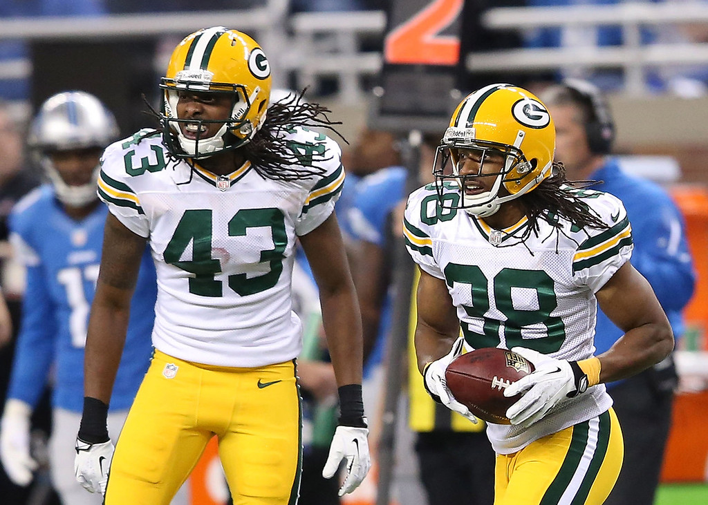. Tarmon Williams #38 of the Green Bay Packers celebrates with team-mate M.D. Jennings after intercepting a pass from Matthew Stafford #9 of the Detroit Lions during the second quarter of the game at Ford Field on November 28, 2013 in Detroit, Michigan.  (Photo by Leon Halip/Getty Images)