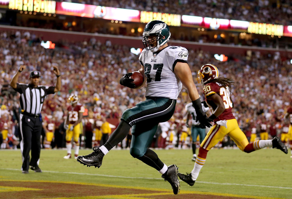 Description of . Tight end Brent Celek #87 of the Philadelphia Eagles celebrates as he catches a 28-yard touchdown in the second quarter against the Washington Redskins at FedExField on September 9, 2013 in Landover, Maryland.  (Photo by Rob Carr/Getty Images)