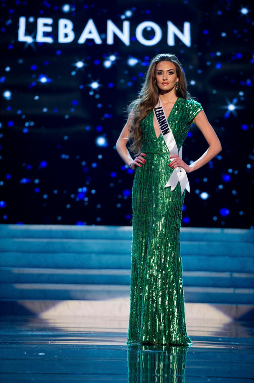 Description of . Miss Lebanon 2012 Rina Chibany competes in an evening gown of her choice during the Evening Gown Competition of the 2012 Miss Universe Presentation Show in Las Vegas, Nevada, December 13, 2012. The Miss Universe 2012 pageant will be held on December 19 at the Planet Hollywood Resort and Casino in Las Vegas. REUTERS/Darren Decker/Miss Universe Organization L.P/Handout
