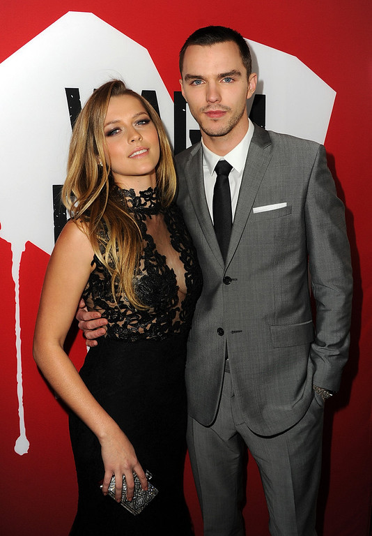 "Description of . Actors Teresa Palmer and Nicholas Hoult arrive for the Los Angeles premiere of Summit Entertainment\'s ""Warm Bodies\"" at ArcLight Cinemas Cinerama Dome on January 29, 2013 in Hollywood, California.  (Photo by Kevin Winter/Getty Images)"
