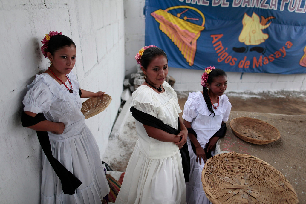 . Dancers in traditional costumes wait to perform a dance during a visit by deputies of the Indigenous Parliament of America (PIA) at the indigenous community of Monimbo in Masaya City, about 24 km (15 miles) south of Managua, April 10, 2013. Indigenous representatives from Bolivia, Chile, Colombia, Ecuador, Guatemala, Honduras, Mexico, Nicaragua, Panama, Peru and Venezuela will analyze the food security of their peoples during the 13th ordinary session of the PIA held in the city of Managua. REUTERS/Oswaldo Rivas