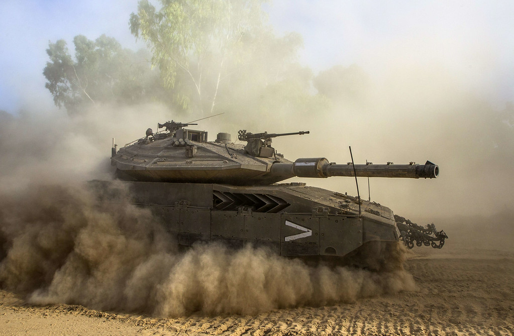 Description of . An Israeli Merkava tank deploys at an army deployment area near Israel's border with the Gaza Strip on July 17, 2014. Fighting between Israel and Hamas resumed in deadly earnest today, after a brief humanitarian ceasefire allowed Gaza residents to restock and hunker down, and as efforts towards a lasting truce intensified. AFP PHOTO / JACK GUEZ/AFP/Getty Images
