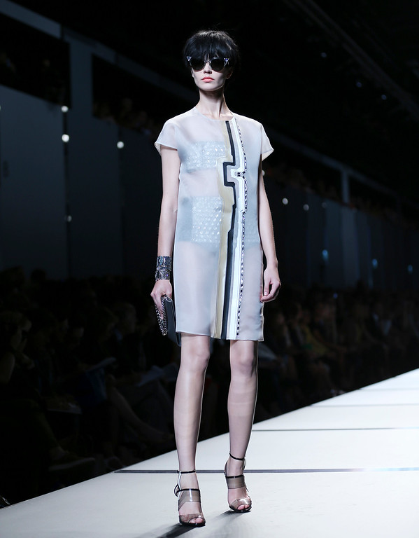 Description of . A model wears a creation for Fendi  women's Spring-Summer 2014 collection, part of the Milan Fashion Week, unveiled in Milan, Italy, Thursday, Sept. 19, 2013. (AP Photo/Antonio Calanni)