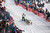 Cim Smyth's team races down the trail at the re-start of the Iditarod dog sled race in Willow, Alaska  March 3, 2013. From Willow, the race runs for almost 1000 miles as it crosses the state. 