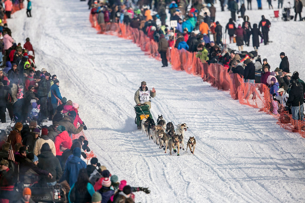 . Cim Smyth\'s team races down the trail at the re-start of the Iditarod dog sled race in Willow, Alaska  March 3, 2013. From Willow, the race runs for almost 1000 miles as it crosses the state.   REUTERS/Nathaniel Wilder