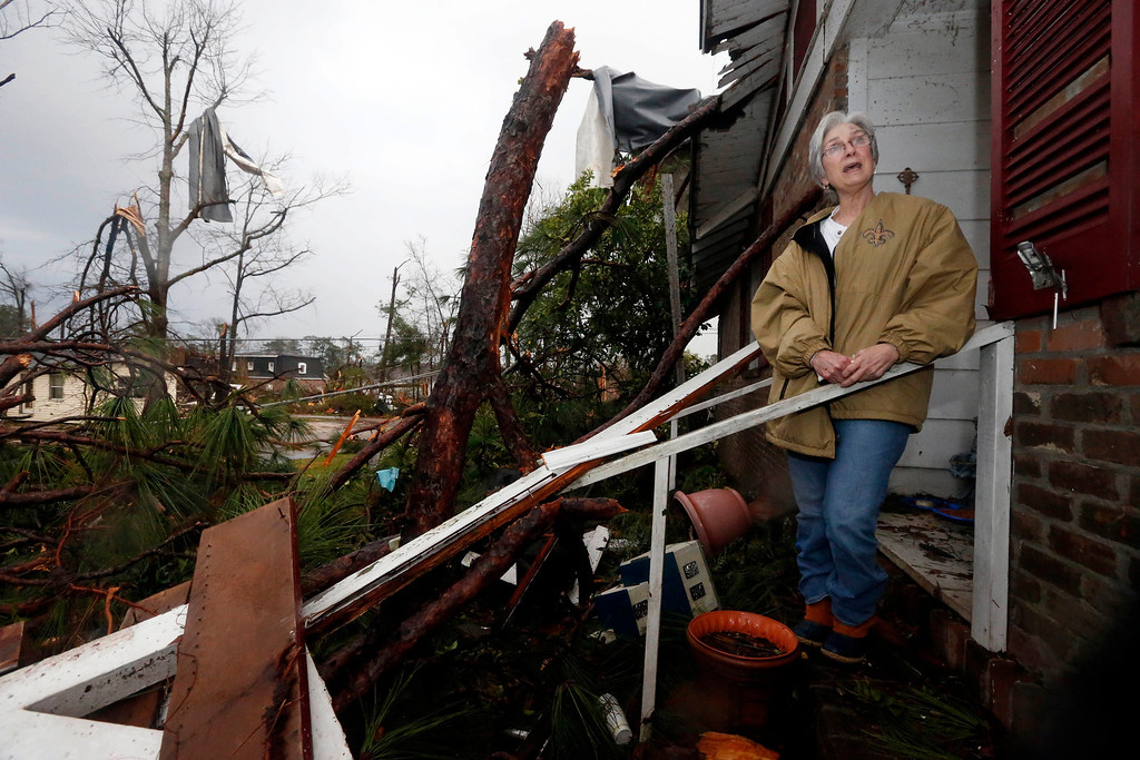 Description of . Marie Key, 68, said she is hoping to salvage what she can Monday morning, Feb. 11, 2013 at her Hattiesburg, Miss., home following Sunday\'s tornado. She was alone in her one-story brick house when the storm hit and dove under a kitchen table, hitting her head. At least three trees hit her house, which she said was also damaged during Hurricane Katrina and another storm in 1998. (AP Photo/Rogelio V. Solis)