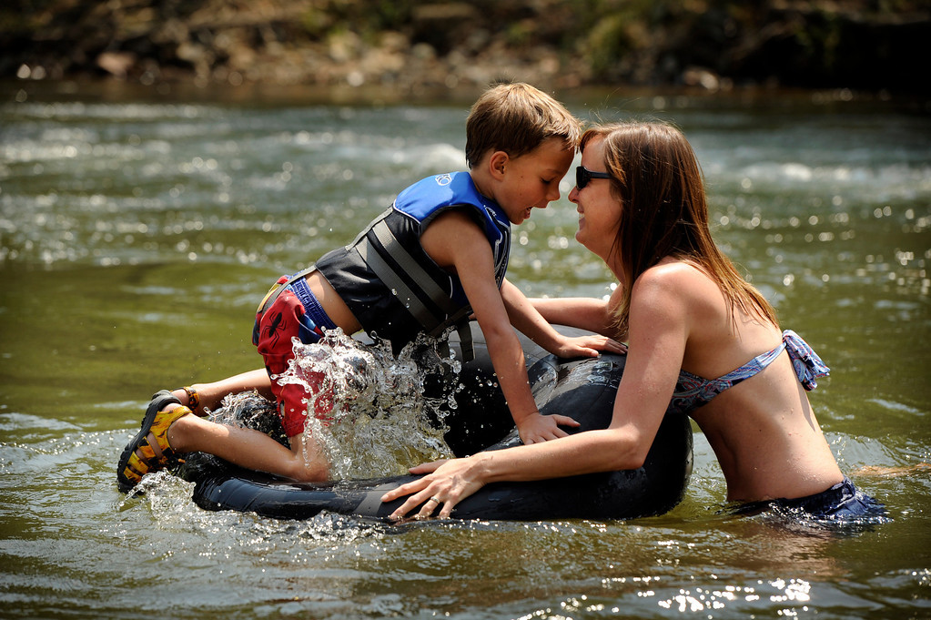 Description of . Julie Fulkerson and her son Owen, 5,  cool off at the Clear Creek Whitewater Park in Golden, CO, Tuesday, August 14, 2012. The pair spent the day on the water with friends and family during her last week of summer break. Julie said her son is looking forward to his first day of kindergarten,