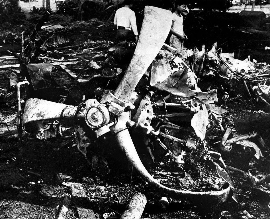 Description of . Youths inspect the wreckage of a Japanese bomber, Dec. 17, 1941 brought down by a United States P-40 plane during the Dec 7, 1941 attack on Oahu, Hawaii. (AP Photo)