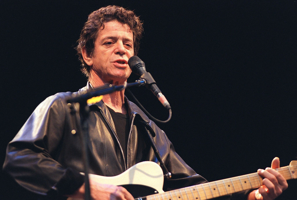 Description of . In this July 30, 2000 file photo, Lou Reed performs on stage at the open air