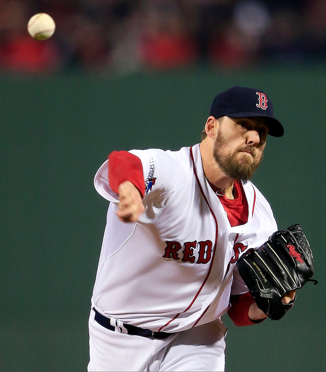 Description of . Boston Red Sox starting pitcher John Lackey throws during the first inning of Game 6 of baseball's World Series against the St. Louis Cardinals Wednesday, Oct. 30, 2013, in Boston. (AP Photo/Jamie Squire, Pool)