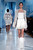 Models present creations by Russian designer Valentin Yudashkin as part of his Fall-Winter 2013/2014 women's ready-to-wear fashion show during Paris fashion week March 4, 2013. REUTERS/Benoit Tessier