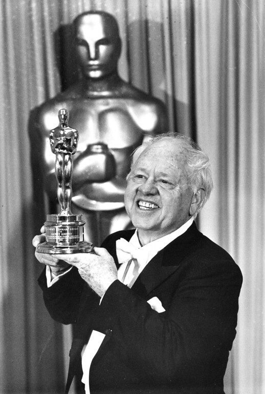 Description of . Actor Mickey Rooney poses with his Honorary Oscar for Lifetime Achievement at the 55th Annual Academy Awards ceremony in Los Angeles, Ca., April 10, 1983.  Rooney is honored for his 60 years of contribution to the motion picture industry.  (AP Photo)