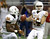 Texas' David Ash (14) looks to pass to Johnathan Gray (32) during the first quarter of the Alamo Bowl NCAA football game against Oregon State, Saturday, Dec. 29, 2012, in San Antonio.  (AP Photo/Eric Gay)
