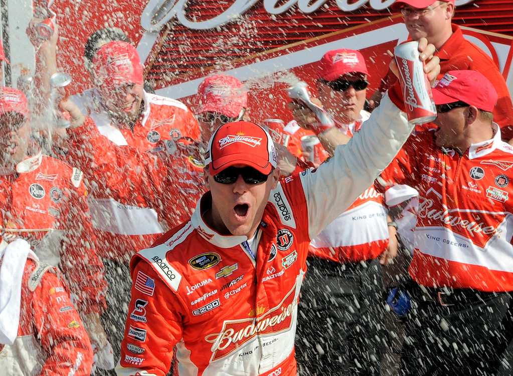 Description of . Kevin Harvick celebrates in the victory lane with his crew after winning the first NASCAR Sprint Cup Series Budweiser Duel at the Daytona International Speedway in Daytona Beach, Florida February 21, 2013. The two Duel races determine starting positions for the field for the Daytona 500 NASCAR Sprint Cup race, scheduled for February 24.  REUTERS/Brian Blanco