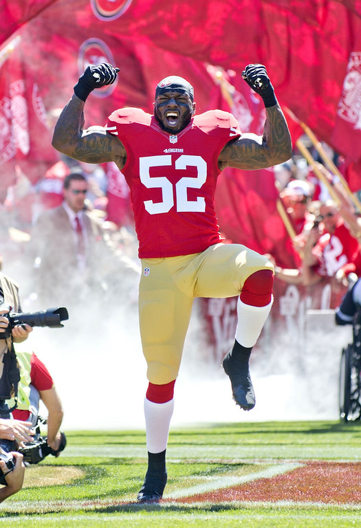 Description of . San Francisco 49ers inside linebacker Patrick Willis (52) is introduced during the San Francisco 49ers home opener against the Green Bay Packers at Candlestick Park in San Francisco, California, on Sunday, September 8, 2013. (Hector Amezcua/Sacramento Bee/MCT)