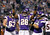 Minnesota Vikings running back Adrian Peterson (28) celebrates with teammate Jerome Felton, right, after scoring on a 1-yard touchdown run during the first half of an NFL football game against the Chicago Bears Sunday, Dec. 9, 2012, in Minneapolis. (AP Photo/Genevieve Ross)