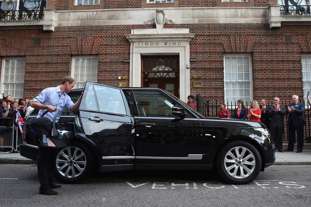 Description of . Prince William, Duke of Cambridge leaves the Lindo Wing of St Mary\'s Hospital with his newborn son on July 23, 2013 in London, England.  The Duchess of Cambridge yesterday gave birth to a boy at 16.24 BST and weighing 8lb 6oz, with Prince William at her side. The baby, as yet unnamed, is third in line to the throne and becomes the Prince of Cambridge.  (Photo by Oli Scarff/Getty Images)