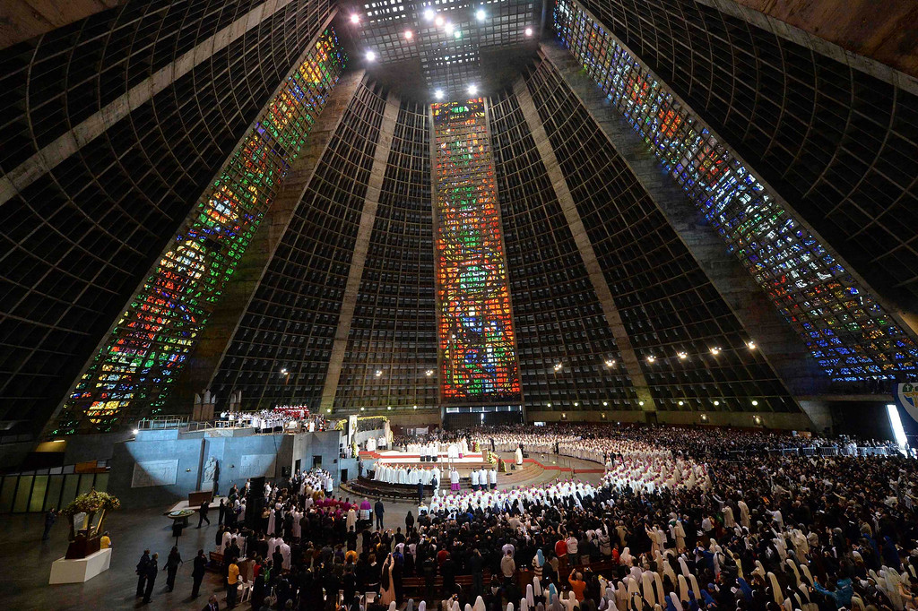 Description of . A view is seen inside the Sao Sebastiao Cathedral as Pope Francis celebrates mass in Rio de Janeiro, July 27, 2013. Pope Francis told Catholic clergy on Saturday to leave their comfort zones and smug surroundings and reach out to serve the poor and needy.  REUTERS/Luca Zennaro