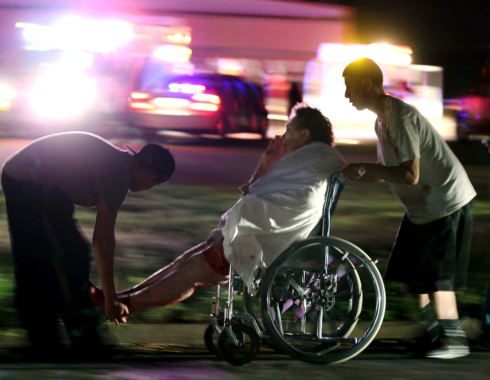 Description of . An injured elderly person is assisted by two young males as a nursing home is evacuated after an explosion at a nearby fertilizer plant Wednesday, April 17, 2013, in West, Texas. (AP Photo/Waco Tribune Herald, Rod Aydelotte)