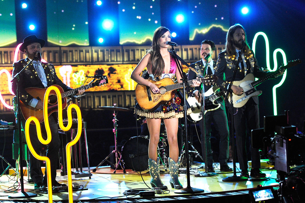 Description of . Singer Kacey Musgraves performs onstage during the 56th GRAMMY Awards at Staples Center on January 26, 2014 in Los Angeles, California.  (Photo by Kevork Djansezian/Getty Images)