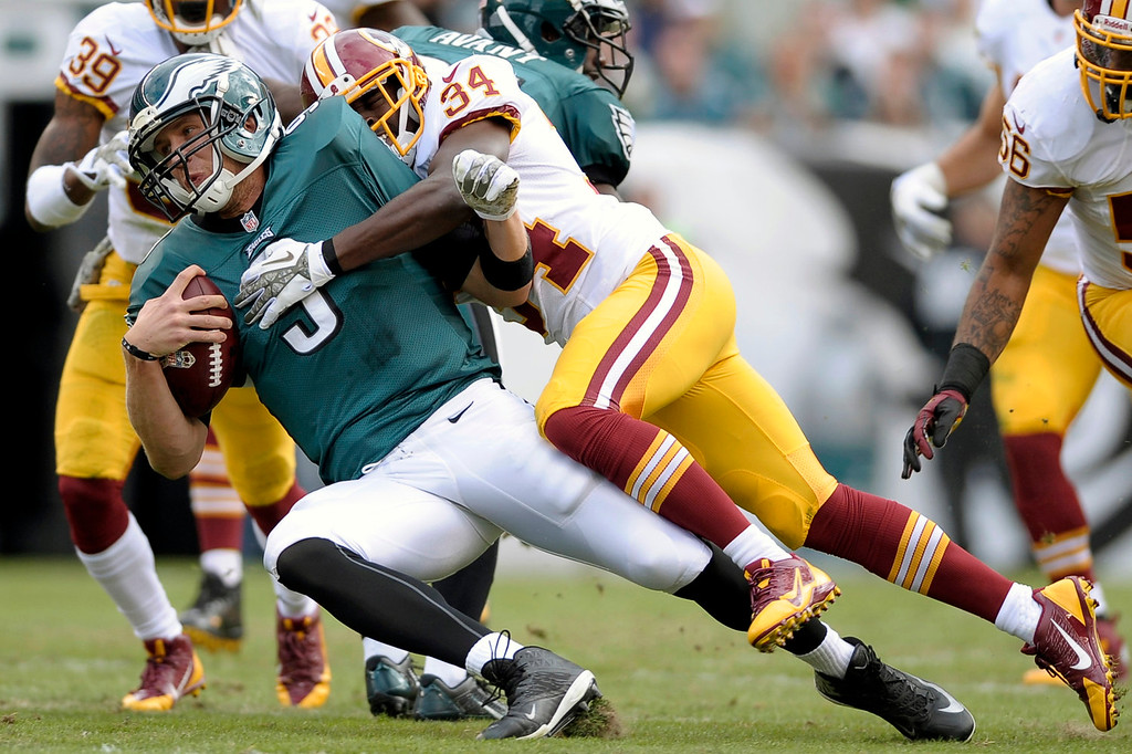 Description of . Philadelphia Eagles quarterback Nick Foles is sacked by Washington Redskins defensive back Trenton Robinson during the first half of an NFL football game in Philadelphia, Sunday, Nov. 17, 2013. (AP Photo/Michael Perez)