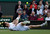 In this June 30, 2012 file photo, Andy Murray of Britain struggles to try and return a shot to Marcos Baghdatis of Cyprus during a third round men's singles match at the All England Lawn Tennis Championships at Wimbledon, England. (AP Photo/Anja Niedringhaus, File)