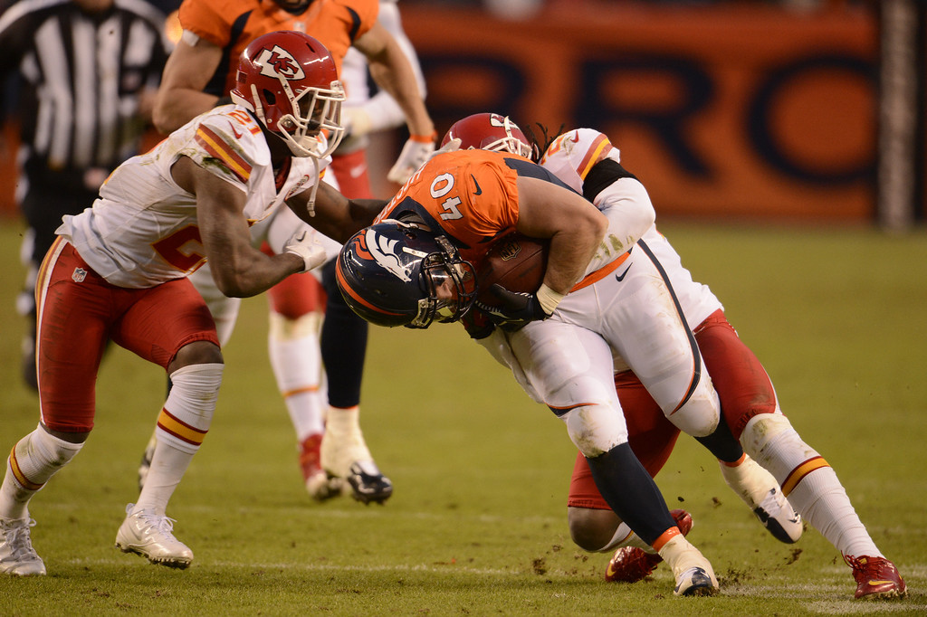 Description of . Denver Broncos running back Jacob Hester (40) gets tackled in the fourth quarter as the Denver Broncos took on the Kansas City Chiefs at Sports Authority Field at Mile High in Denver, Colorado on December 30, 2012. John Leyba, The Denver Post