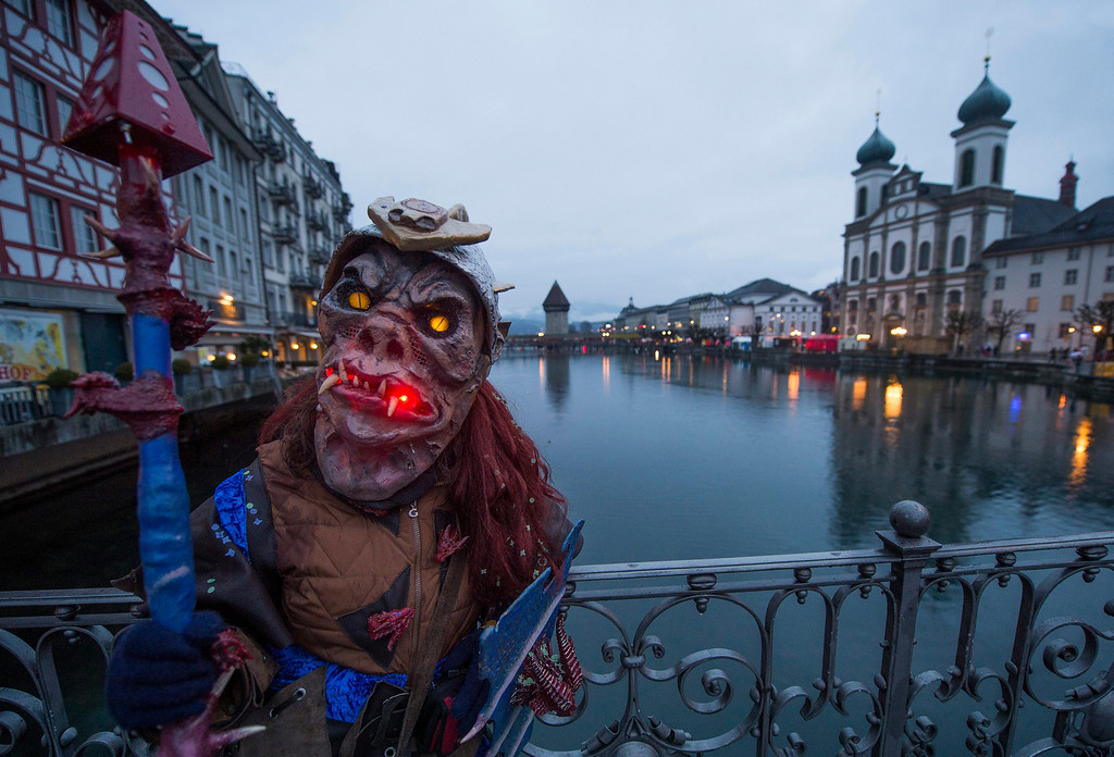 Description of . A carnival participant in costume poses in the historic center of Lucerne, Switzerland, 27 February 2014.  EPA/SIGI TISCHLER