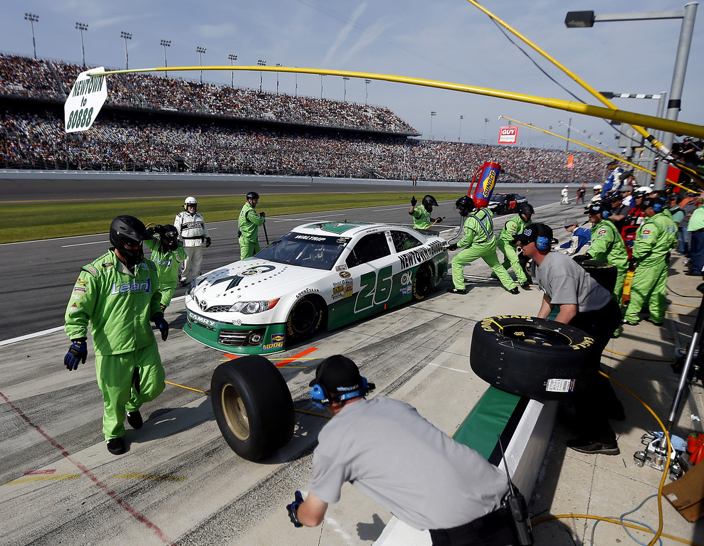 Description of . Michael Waltrip, driver of the #26 Sandy Hook School Support Fund Toyota, pits during the NASCAR Sprint Cup Series Budweiser Duel 1 at Daytona International Speedway on February 21, 2013 in Daytona Beach, Florida.  (Photo by Chris Graythen/Getty Images)