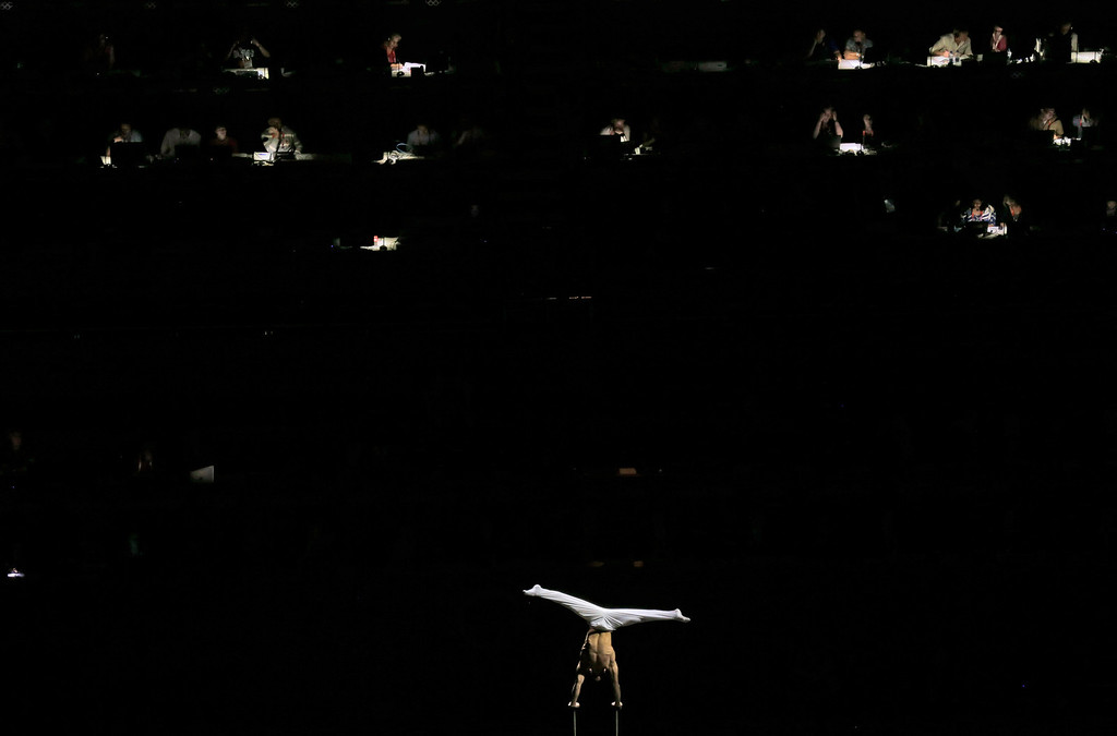 . In this Aug. 5, 2012 file photo, an artist performs during a pre-show for the artistic gymnastics apparatus finals at the 2012 Summer Olympics in London. (AP Photo/Gregory Bull, File)