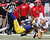 St. Louis Rams outside linebacker Rocky McIntosh collides with San Francisco 49ers fullback Bruce Miller during the first half of their NFL football game in St. Louis, Missouri, December 2, 2012.