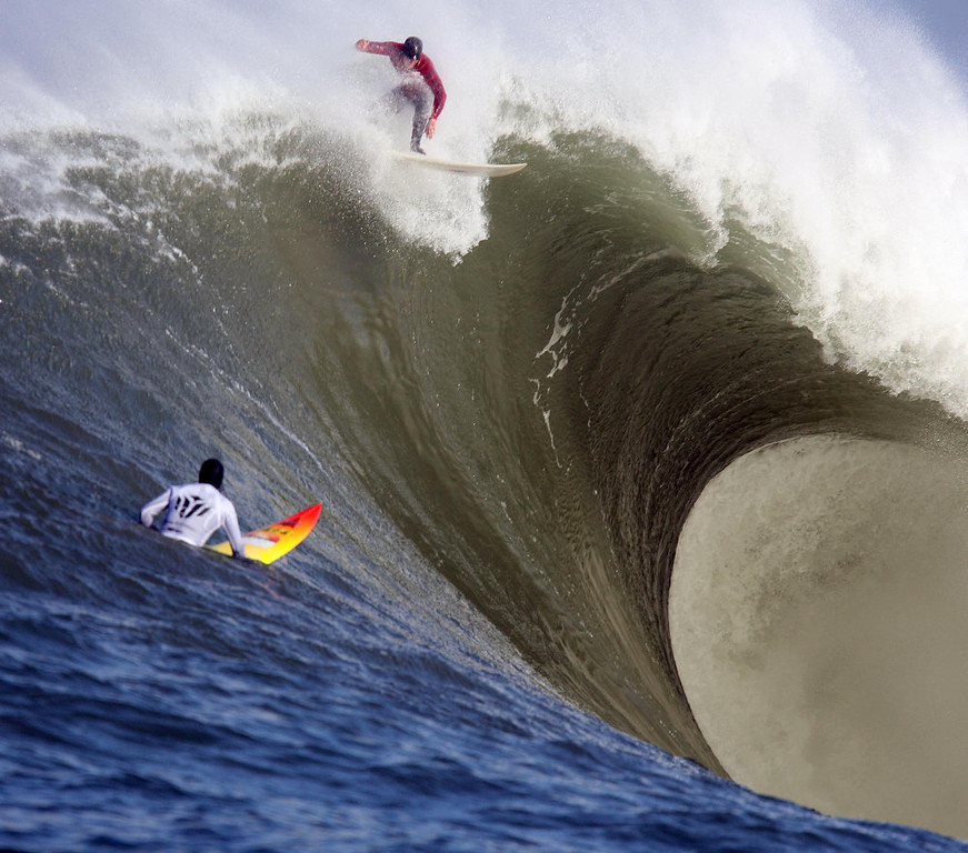 Description of . Evan Slater catches a wave during the first heat of the Mavericks Surf Contest in Princeton-by-the-Sea, Calif., on Saturday, Feb. 13, 2010.  Twenty-four of the world's best big wave surfers are competing. (Jane Tyska/Staff)