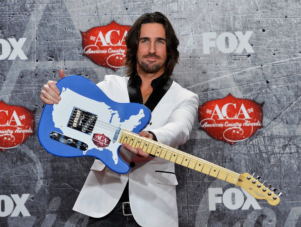 Description of . LAS VEGAS, NV - DECEMBER 10:  Recording artist Jake Owen poses in the press room with his award for Breakthrough Artist of the Year during the 2012 American Country Awards at the Mandalay Bay Events Center on December 10, 2012 in Las Vegas, Nevada.  (Photo by Frazer Harrison/Getty Images)