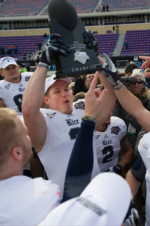 Description of . Taylor Cook #3 of the Rice Owls hoists the trophy after defeating the Air Force Falcons in the Bell Helicopter Armed Forces Bowl on December 29, 2012 at Amon G. Carter Stadium in Fort Worth, Texas.  (Photo by Cooper Neill/Getty Images)