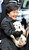 South Korean new President Park Geun-hye holds a puppy presented by her neighbor as she leaves her home for the presidential inauguration ceremony in Seoul, South Korea, Monday, Feb. 25, 2013.  (AP Photo/Yonhap, Kim Hong-Ji)
