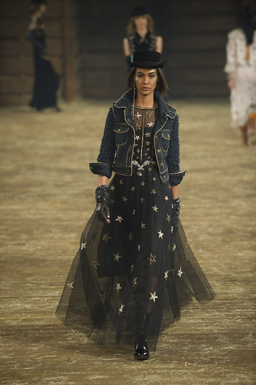 Description of . Model Joan Smalls walks the runway during the Chanel
