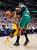 Denver Nuggets guard Ty Lawson, left, is fouled while driving to the basket by Boston Celtics forward Paul Pierce in the fourth quarter of the Nuggets' 97-90 victory in an NBA basketball game in Denver on Tuesday, Feb. 19, 2013. (AP Photo/David Zalubowski)
