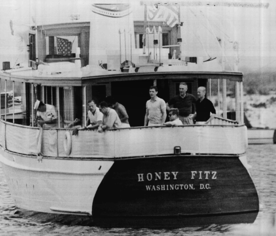 Description of . Kennedy and friends enjoy an afternoon aboard the presidential yacht Honey Fitz off Hyannis Port in 1963. The group includes Lamar Billings; John Reed, Assistant Secretary of Treasury; Patricia Lawford, the president's sister; Steven Smith; Gen. Maxwell Taylor and Roland Evans. Denver Post file