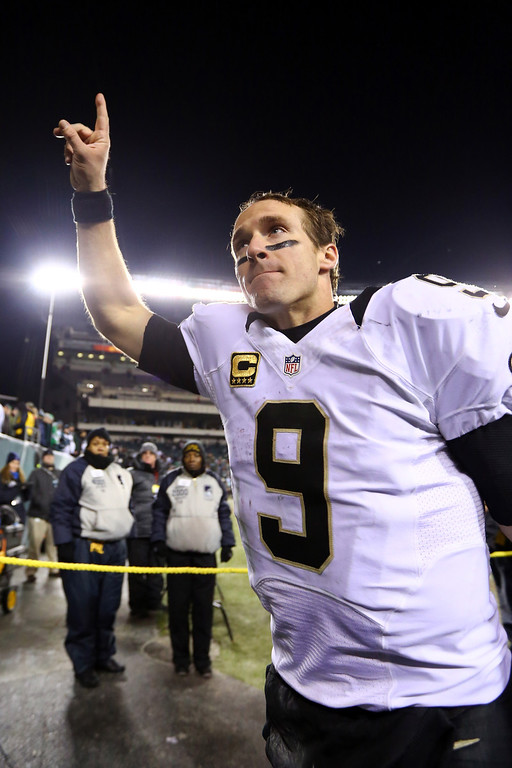 Description of . PHILADELPHIA, PA - JANUARY 04:  Drew Brees #9 of the New Orleans Saints celebrates as he runs off the field after defeating the Philadelphia Eagles in their NFC Wild Card Playoff game at Lincoln Financial Field on January 4, 2014 in Philadelphia, Pennsylvania. The New Orleans Saints defeated the Philadelphia Eagles 26 - 24.  (Photo by Al Bello/Getty Images)