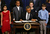 U.S. President Barack Obama is flanked by young children as he signs a executive order designed to tackle gun control, on January 16, 2012 in Washington, DC. One month after a massacre that left 20 school children and 6 adults dead in Newtown, Connecticut, the president unveiled a package of gun control proposals that include universal background checks and bans on assault weapons and high-capacity magazines.  (Photo by Mark Wilson/Getty Images)