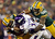 Quarterback Joe Webb #14 of the Minnesota Vikings is tackled by inside linebacker Brad Jones #59 and defensive tackle Mike Neal #96 of the Green Bay Packers in the fourth quarter during the NFC Wild Card Playoff game at Lambeau Field on January 5, 2013 in Green Bay, Wisconsin.  (Photo by Andy Lyons/Getty Images)