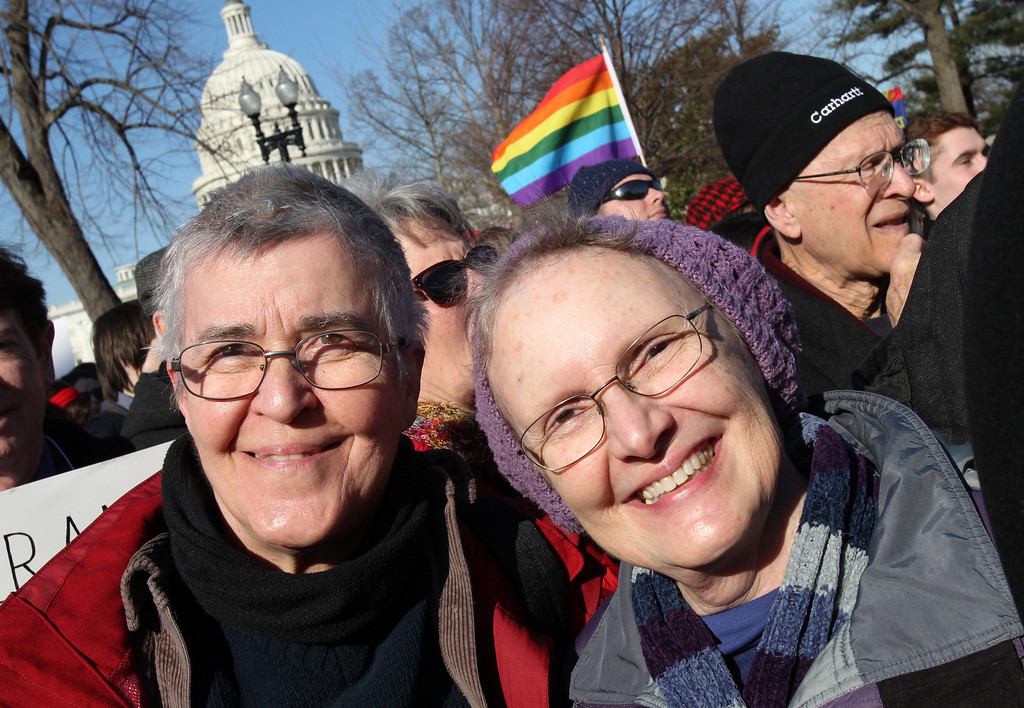 Description of . Jo Ann Whitehead, left, and Bette Jo Green joined the marriage equality supporters at the Supreme Court as the justices heard the case Hollingsworth v. Perry, a challenge to California\'s Proposition 8, on Tuesday, March 26, 2013 in Washington, D.C. (Paul Morigi/AP Images for Human Rights Campaign)