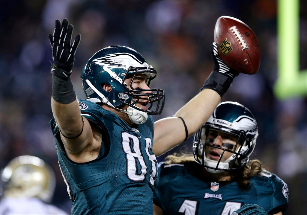 Description of . Philadelphia Eagles' Zach Ertz, center, celebrates with Riley Cooper after his touchdown during the second half of an NFL wild-card playoff football game against the New Orleans Saints, Saturday, Jan. 4, 2014, in Philadelphia. (AP Photo/Michael Perez)