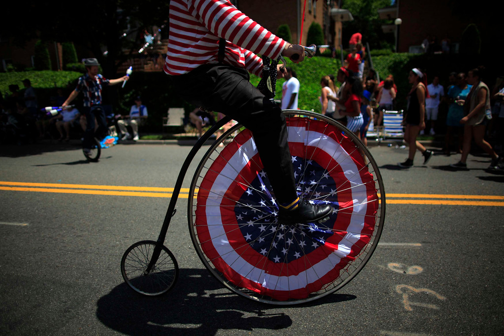 Description of . People take part in an Independence Day parade in Ridgefield Park, New Jersey July 4, 2013. REUTERS/Eric Thayer