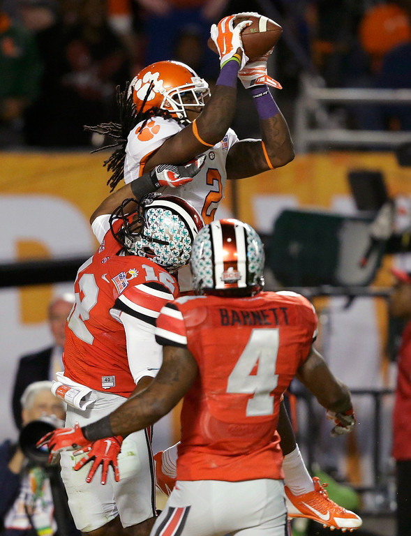 Description of . Clemson wide receiver Sammy Watkins (2) makes a catch for a touchdown over Ohio State cornerback Doran Grant (12) and safety C.J. Barnett (4) during the second half of the Orange Bowl NCAA college football game, Friday, Jan. 3, 2014, in Miami Gardens, Fla. (AP Photo/Wilfredo Lee)
