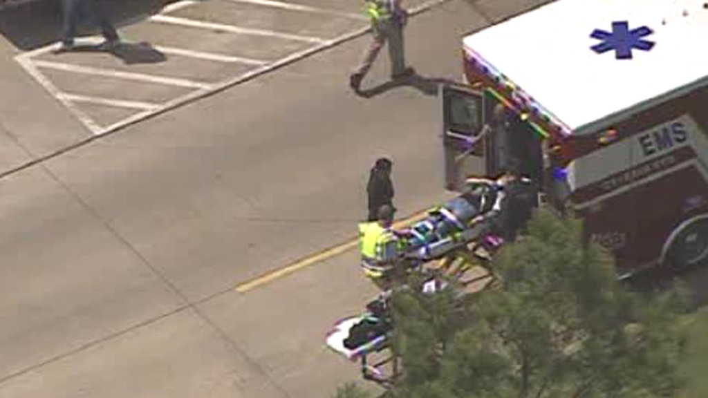 Description of . A person is loaded into an ambulance following a mass stabbing at the Cy-Fair campus of Lone Star College in northwest Houston, as seen in this still image from video courtesy of KPRC-TV April 9, 2013. REUTERS/KPRC-TV