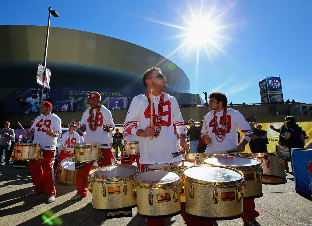 Description of . NEW ORLEANS, LA - FEBRUARY 03: San Francisco 49ers fans perform outside the stadium prior to Super Bowl XLVII against the Baltimore Ravens at the Mercedes-Benz Superdome on February 3, 2013 in New Orleans, Louisiana.  (Photo by Al Bello/Getty Images)