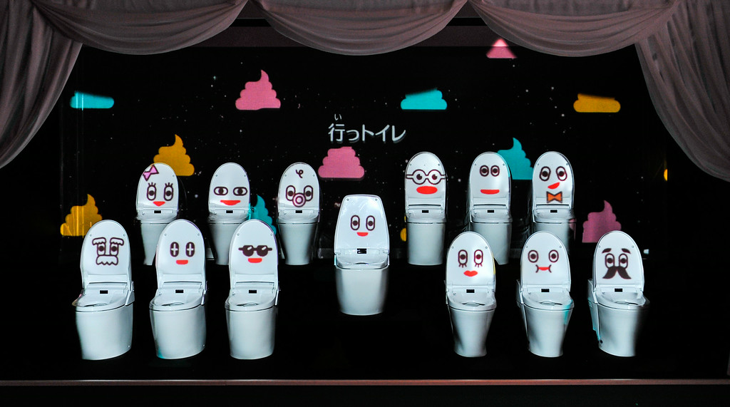 Description of . TOKYO, JAPAN - JULY 01:  Many toilets displayed with cartoon faces are seen during the